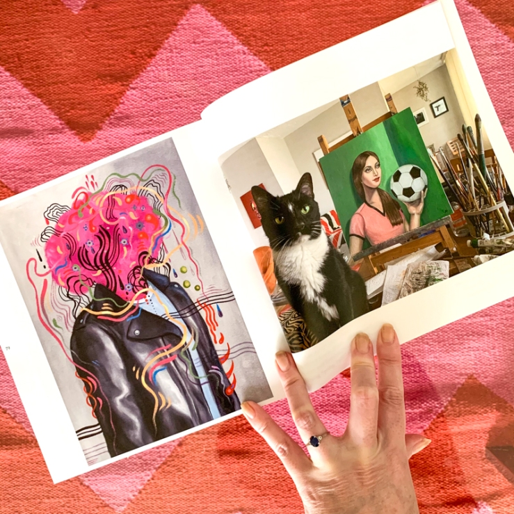 art book with a picture of a tuxedo cat